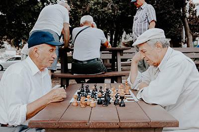 Senior playing chess sm